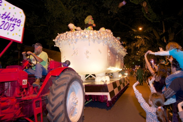 The Bathing Muses, an overflowing bubble bath float, holds members of the all-female krewe as they throw beads and other trinkets, including their famous glitter shoes.
