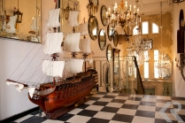 Delos is the most fabulous melange of chandeliers, nautical items, and taxidermy. Wandering through this wonderland is like walking through a dream.