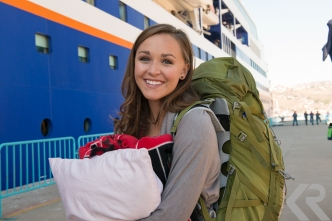 Smiling student boarding ship.