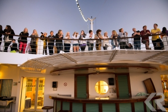 Students on a ship at dusk.