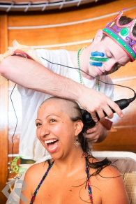 Woman shaving her head.