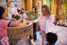 Washing a buddha at the Shwedagon Pagoda.