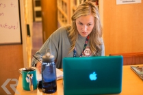 A Semester at Sea student studies in the shipboard library.