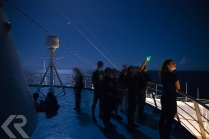 Star gazing from the deck of a ship.