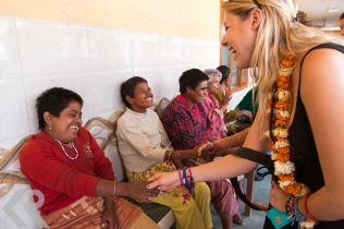 American student visits people at a charity home in India.