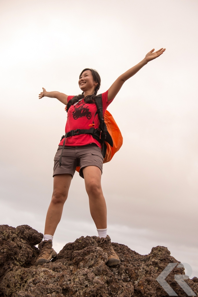 Joyful woman hiking in the Galapagos.