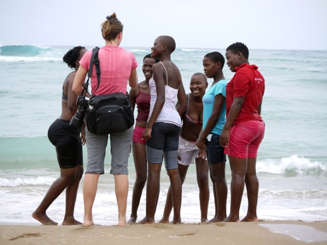 Krista Rossow and South African women on beach in Kwa-Zulu Natal.