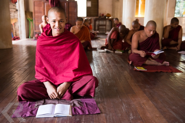 Portrait of a young monk studying at a monastery in Myanmar.