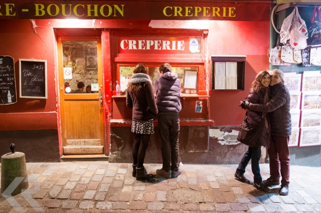 Two couples outside of a crepe stand in Paris