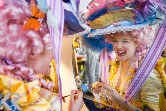 Picture of a woman dressed as Marie Antoinette at Mardi Gras
