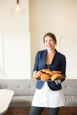 Susannah Gebhart holds a plate of beautiful pastries at her shop, Old World Levain Bakery (OWL).