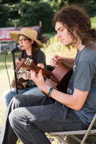 Musicians Kayla Zuskin and Stephen Horvath play together as Fort in the Sky during the weekly River Arts District Farmers Market.